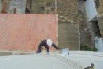 Aplicación de pintura impermeabilizante en medianera , obra en Valencia.